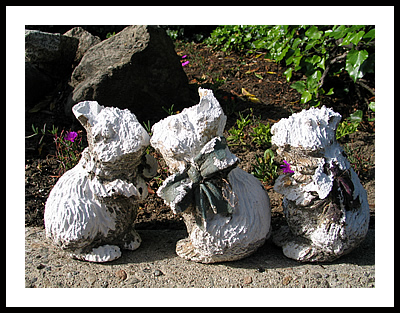 Rabbit statues on a curb