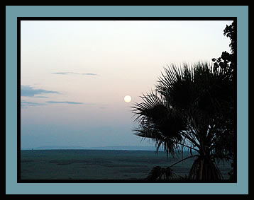 Full moon setting over Masai Mara plains in Kenya