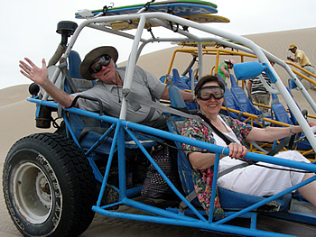 Man and woman enjoying dune buggy ride on their 50th anniversary