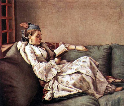Marie Adelaide on sofa with turban and reading a book