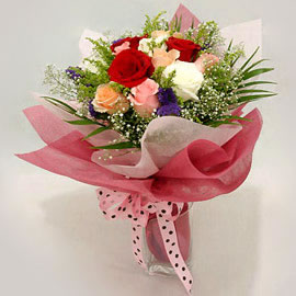 Bouquet of flowers with pink ribbon