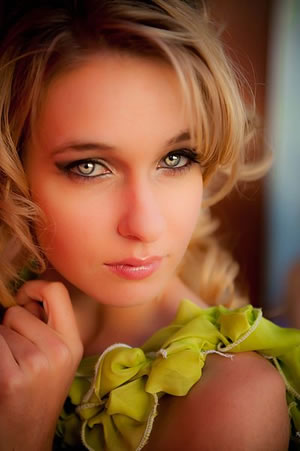 Beautiful model with blonde hair and dark eyes