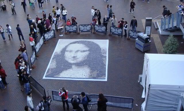 Montage of coffee mugs that created Mona Lisa on the sidewalk