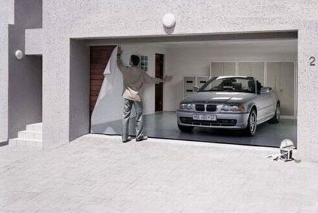 Man papering over garage door
