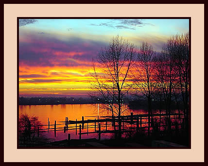 A striking sunset over the Fraser River near Coquitlam, Canada
