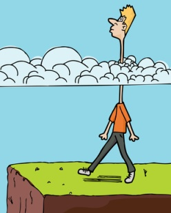 Man about to walk off cliff because he has his head in the clouds